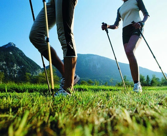Two persons doing Nordic Walking