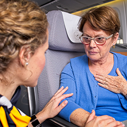 Woman uses CardioSecur on board of an airplane.